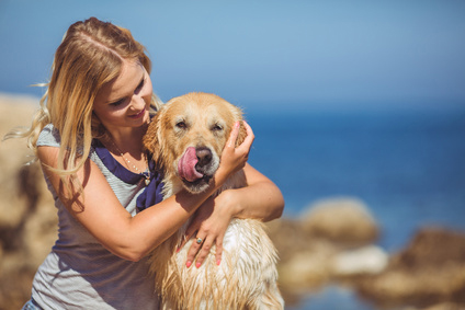 Beautiful-woman-with-her-dog-playing_59203805_XS